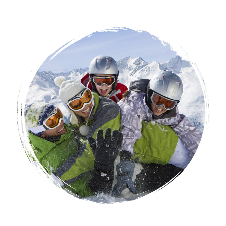 Adventure Travel - Family of Skiiers on Mountain